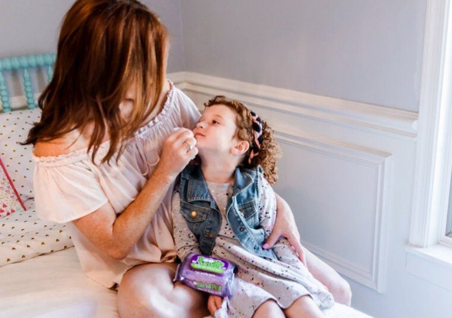Mom and daughter with Boogie Wipes® saline nose wipes
